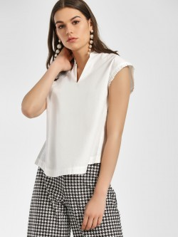 ISU Cut-Out Button Back Blouse