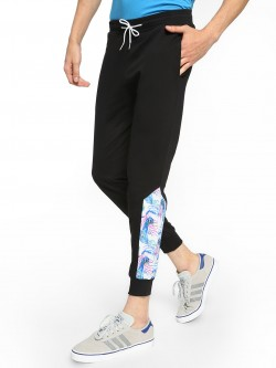 Fighting Fame Peacock Print Panelled Joggers